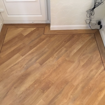 Luxury Vinyl Planks with bespoke border supplied and installed by Michael John Flooring Leicester
