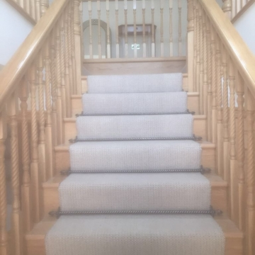 Riviera Bell Air with Dubai Pewter Stair rods supplied and installed by Arighi Bianchi